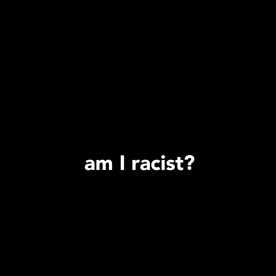 """A black banner with white text that says, """"Am I racist?"""""""